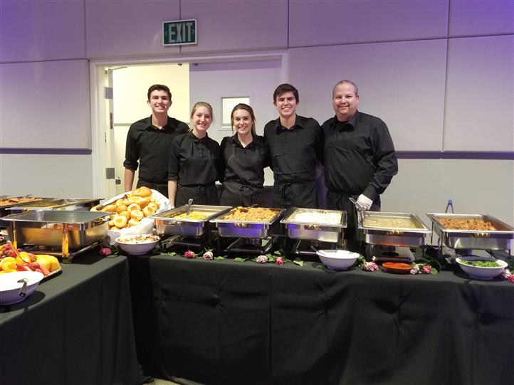catering staff behind the trays