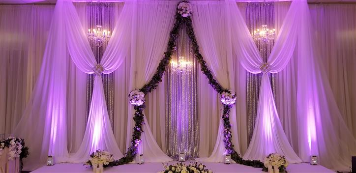 wedding backdrop opening lined with flowers and ivy
