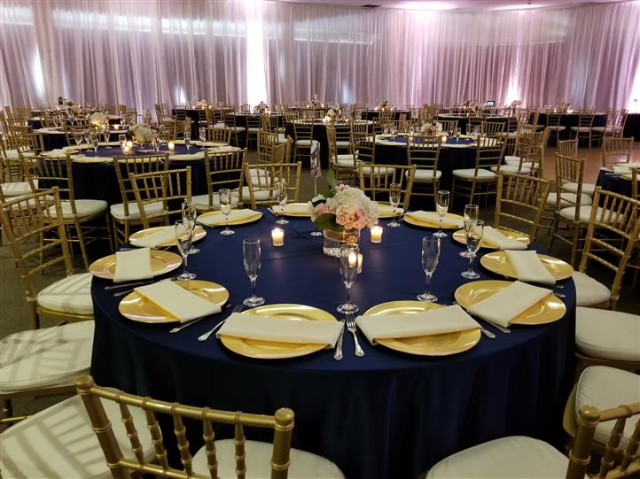 table settings with blue table clothes and gold plates