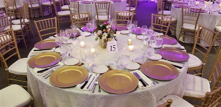 wedding table settings with gold plates and white tableclothes