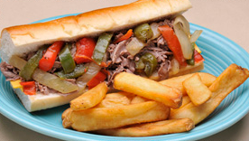 steak sandwich with peppers, with a side of fries