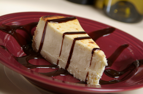 slice of cheesecake with chocolate drizzle