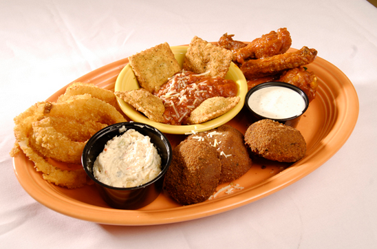 Culpeppers Combo Platter including boneless wings, stuffed mushrooms, toasted ravioli and onion rings served with blue cheese dressing, garlic cream cheese and tomato sauce