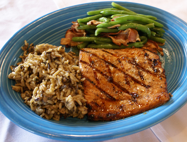 grilled salmon with a side of green ebans and rice