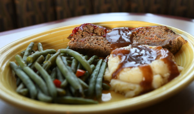 meatloaf with a side of green beans and mashed potatoes
