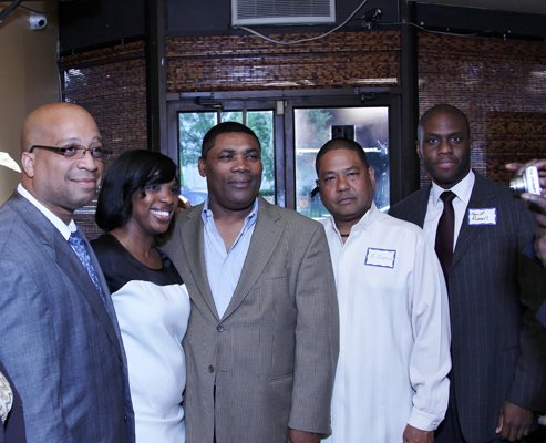 Group photo of people smiling at the Caribbean Business Networking Event