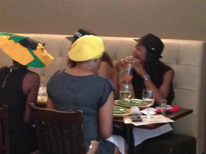 People with hats sitting at the dining area