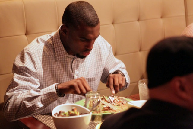 Man eating food at dining table