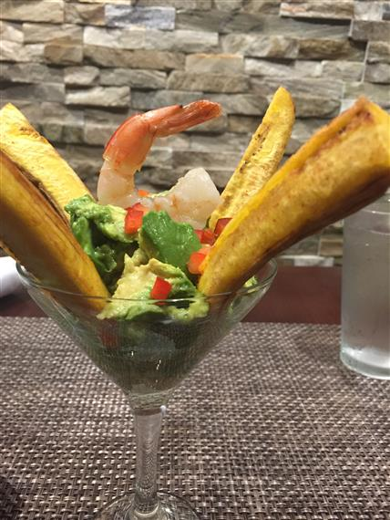 shrimp on top of lettuce in a martini glass
