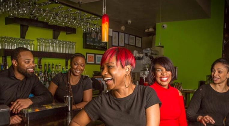 customers smiling and laughing at the bar