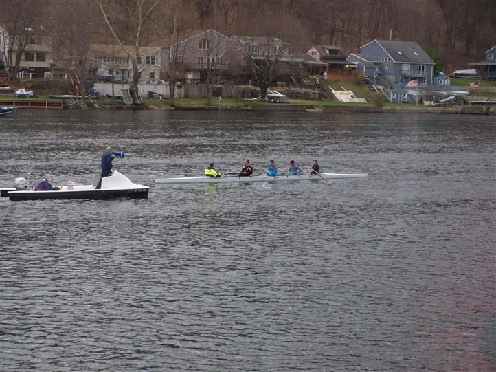 Lake view with people rowing during practice