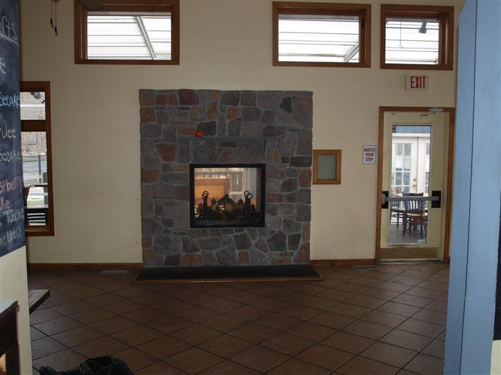New stone face of fireplace