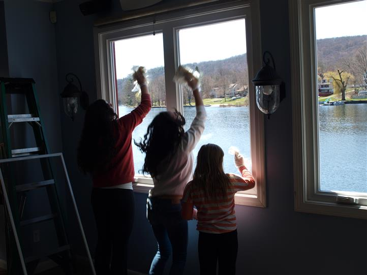 Kids cleaning the windows