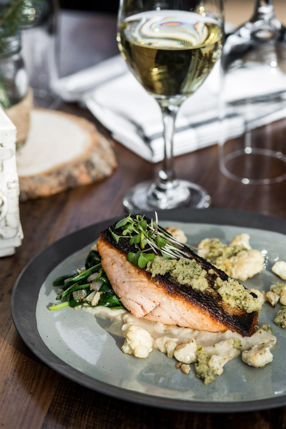 Top view of Pan Seared Salmon - Roasted Cauliflower, Cauliflower Puree, Stone's Throw Green Olive Pesto, Wilted Spinach
