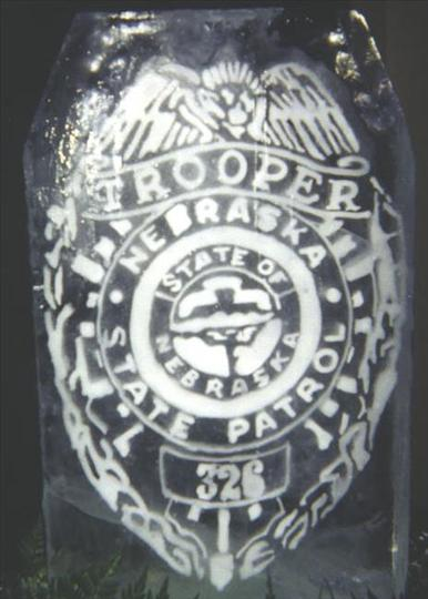 ice sculpture  of Nebraska state patrol seal
