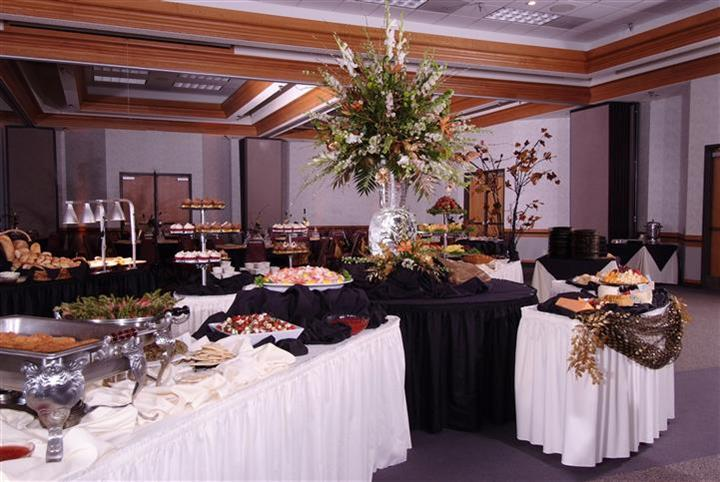 wedding buffet display with large floral centerpiece