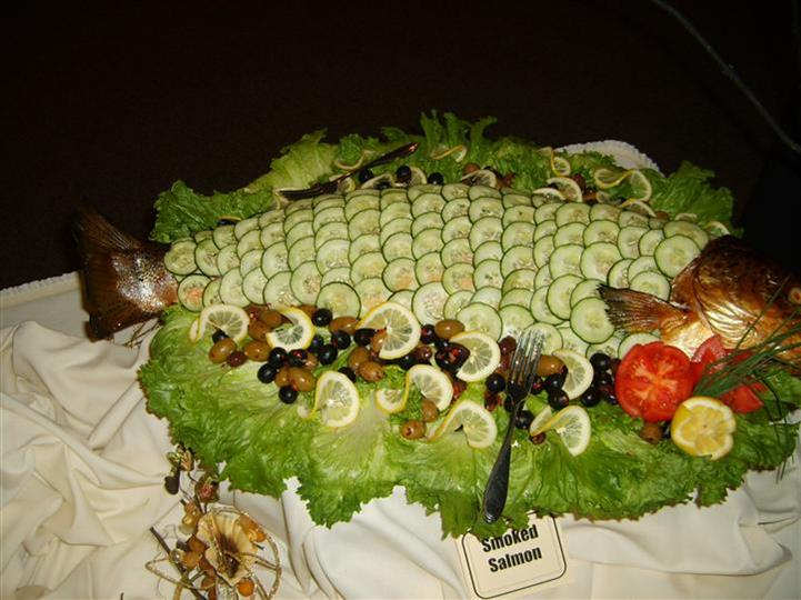 tray of smoked salmon and cucumbers