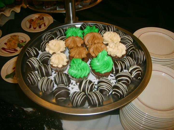 tray of cupcakes and chocolate covered strawberries
