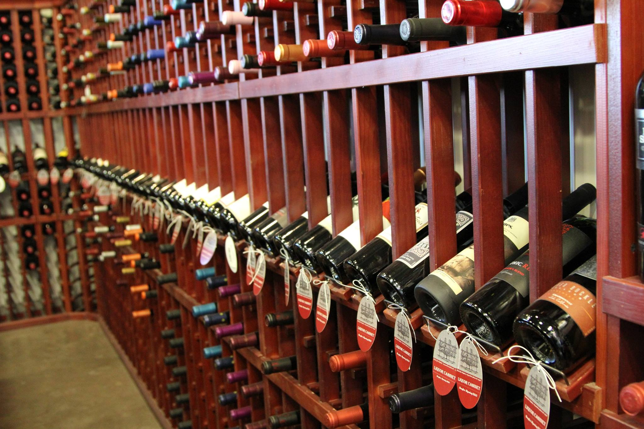 various bottles of wine being stored in wine racks