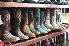 cowboy boots on shelves