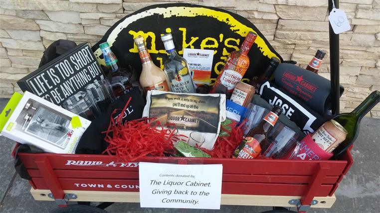 gift basket filled with various drinks and other treats