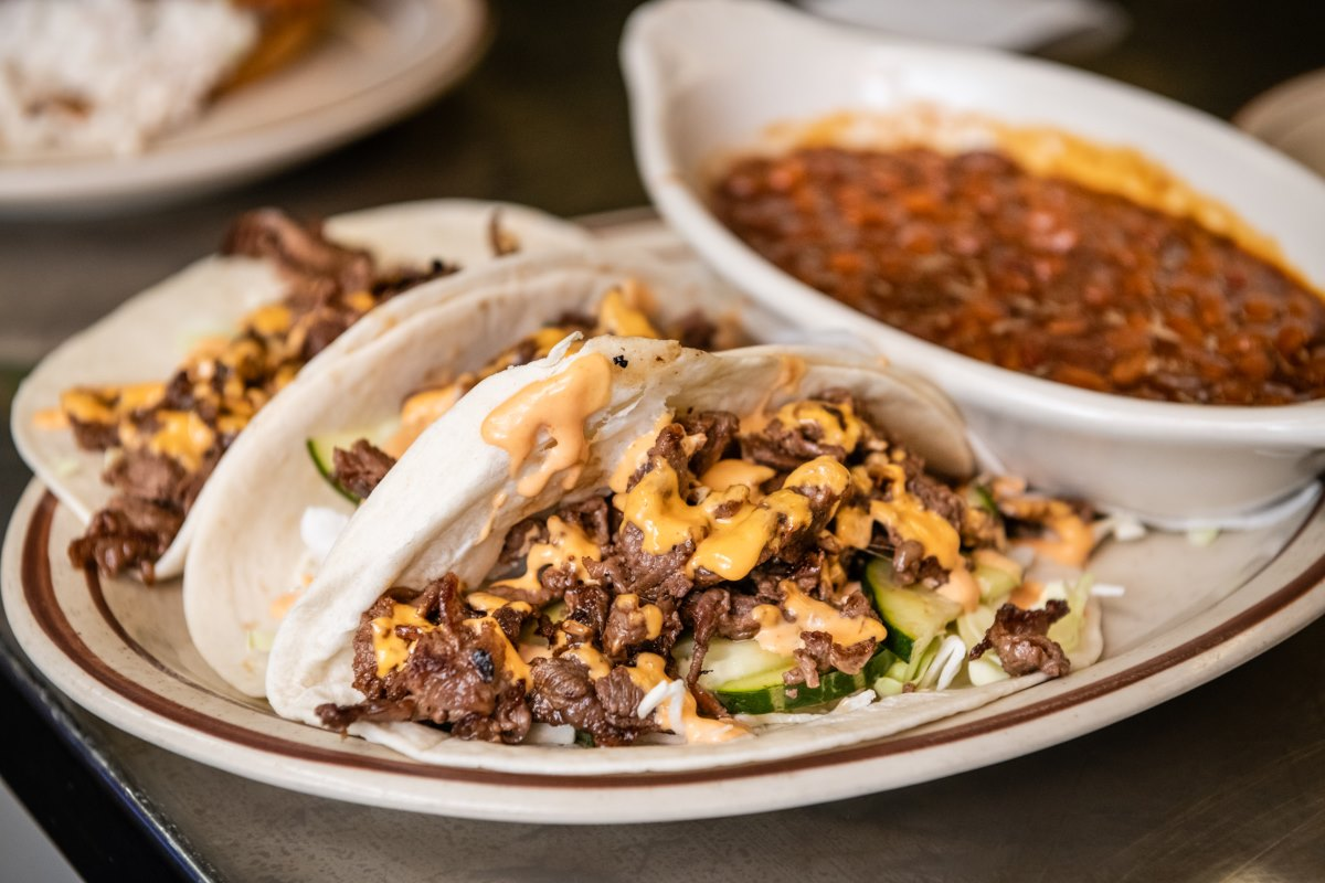Beef BBQ tacos with a side of beans
