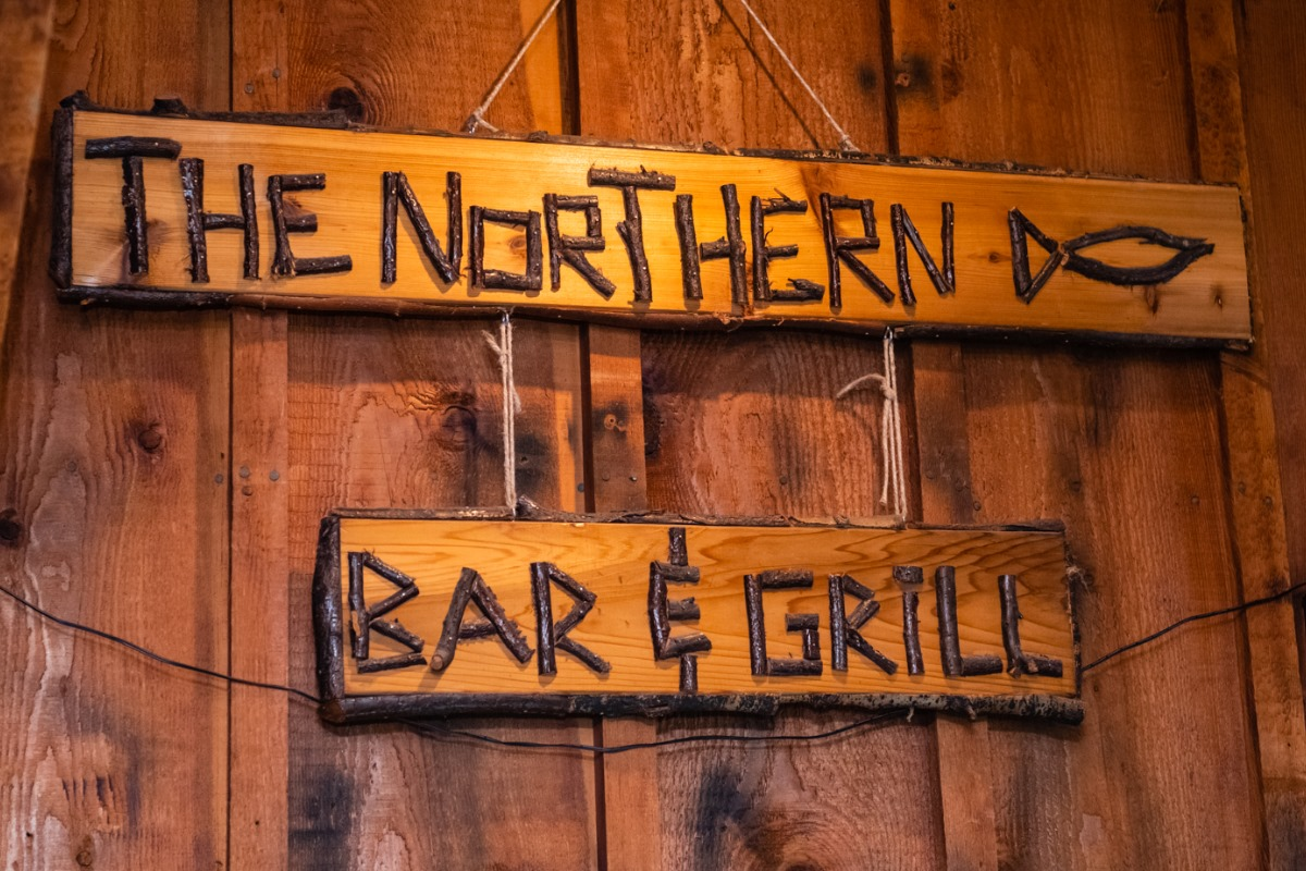 "A wooden sign that reads ""The Northern Bar & Grill"""