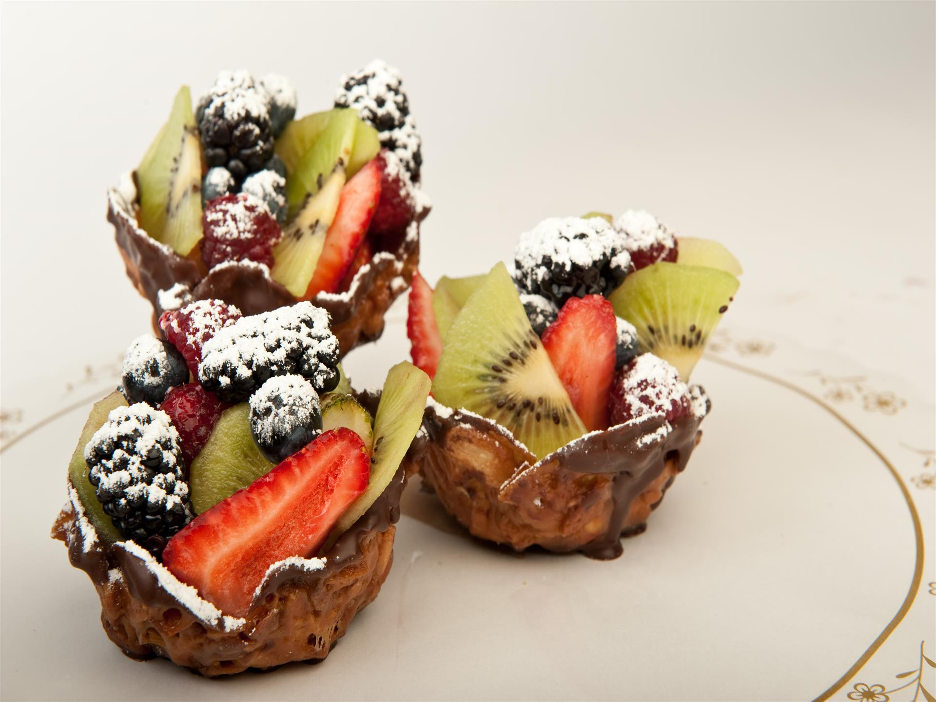 tarts topped with assorted fruit