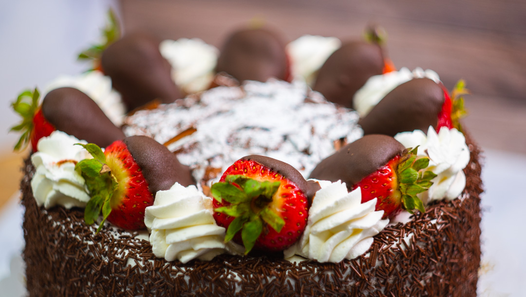 Chocolate Cake.  With chocolate mousse and fresh strawberries.