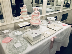 Display table with three tiered cake