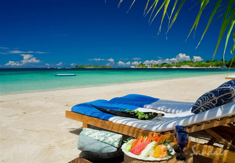 Tropical beach and lounge chair