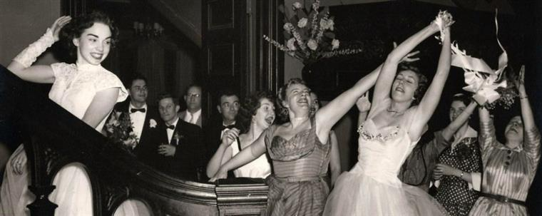 Vintage photo of bouquet toss at wedding