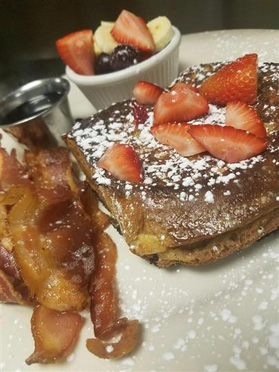 french toast with fruit and a side of bacon