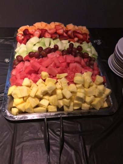 large tray filled with chopped fruit