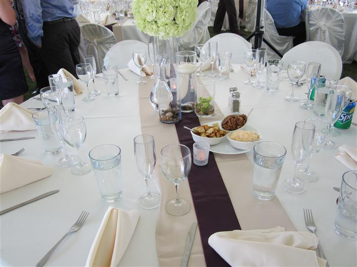 Wine glasses and food on a table