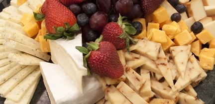 Arrangement of fruits and cheeses