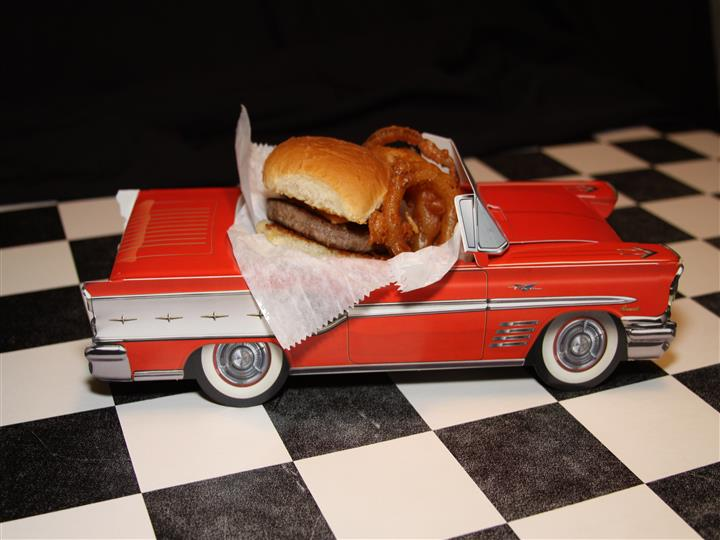 Slider and onion rings in a car