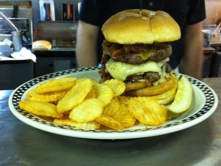 Double bacon cheese burger with a side of chips