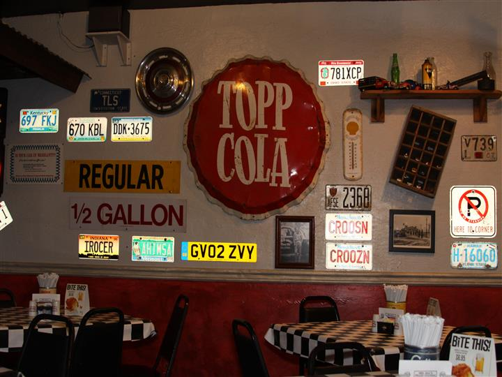 Walls filled with vintage decorations and license plates