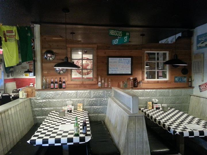 Checkered dining tables with street sign decorations hanging above