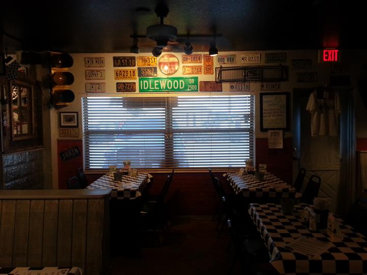 Dining area with license plates decorations on the wall