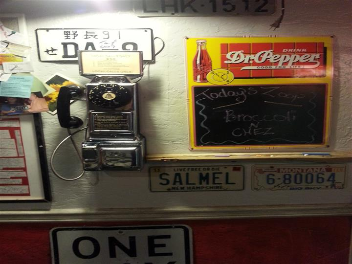 Vintage pay phone and license plates