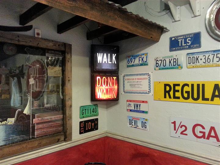 Street signs and license plate decorations