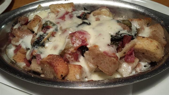 Dish with melted cheese and meat