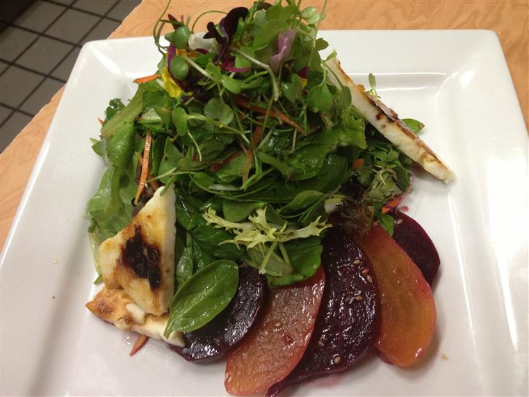 Red and golden beet salad with arugula and caramelized feta cheese