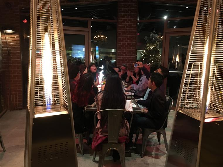 Family dining at table surrounded by various heaters