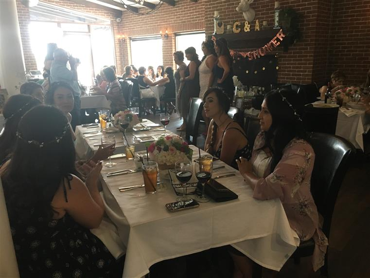 women at a table celebrating a bridal shower