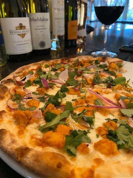 medium pizza and wine special $39