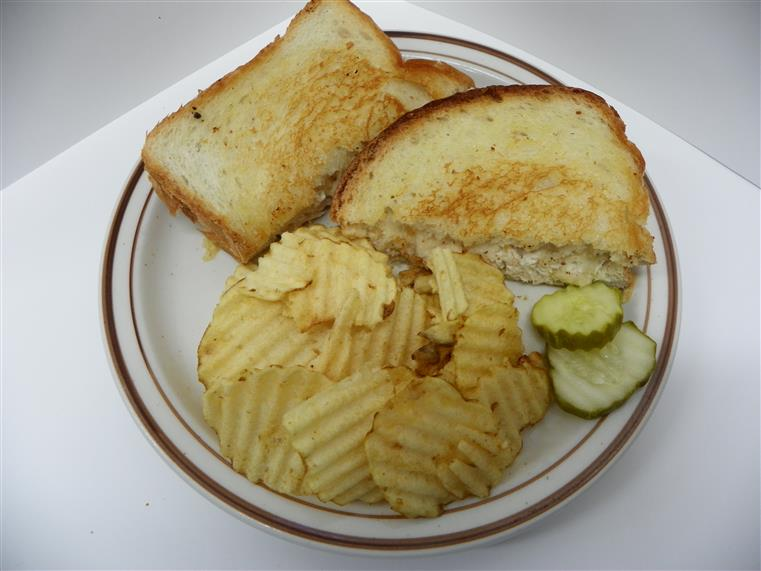 sandwich with potato chips and pickles