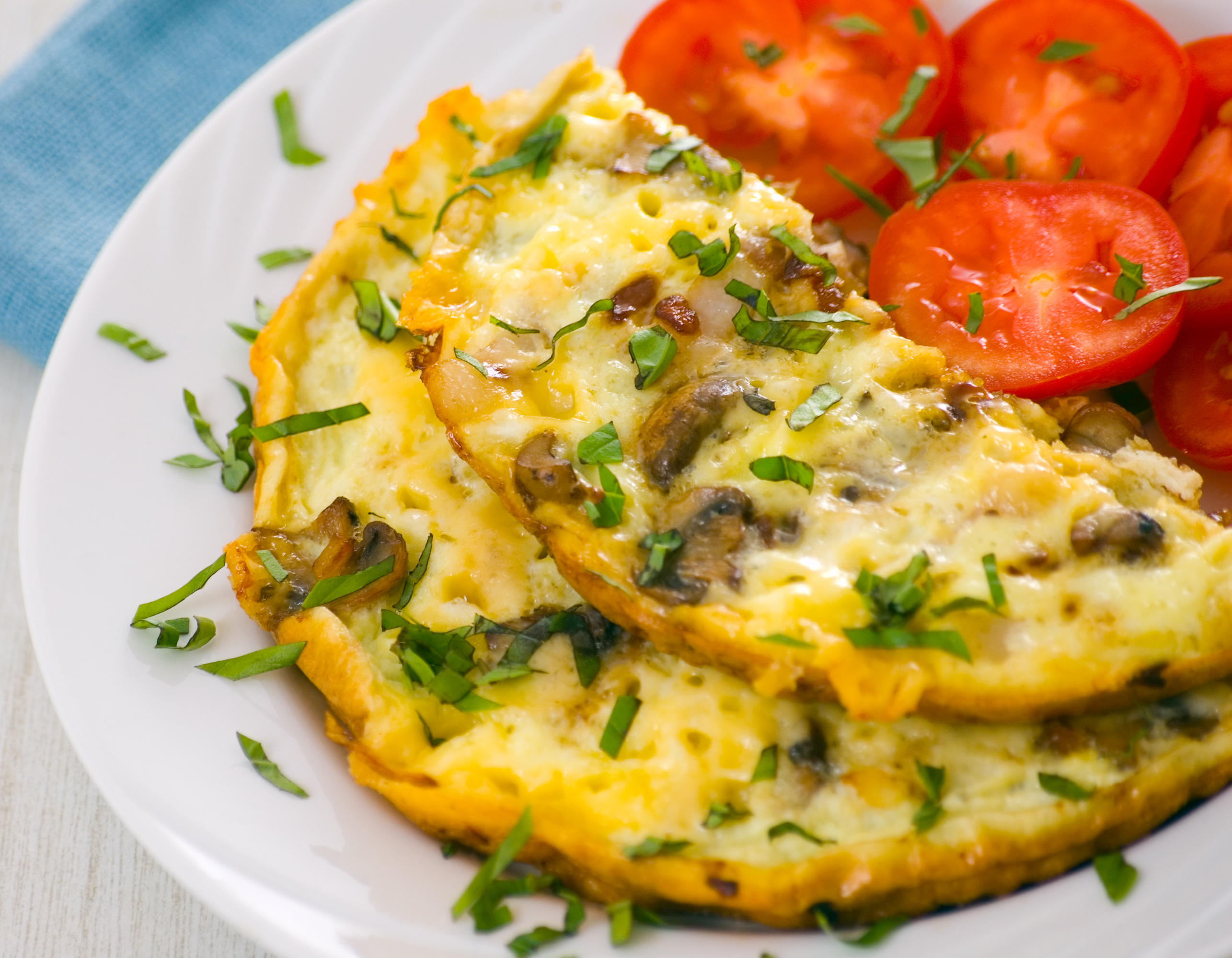 Omelet served with tomato